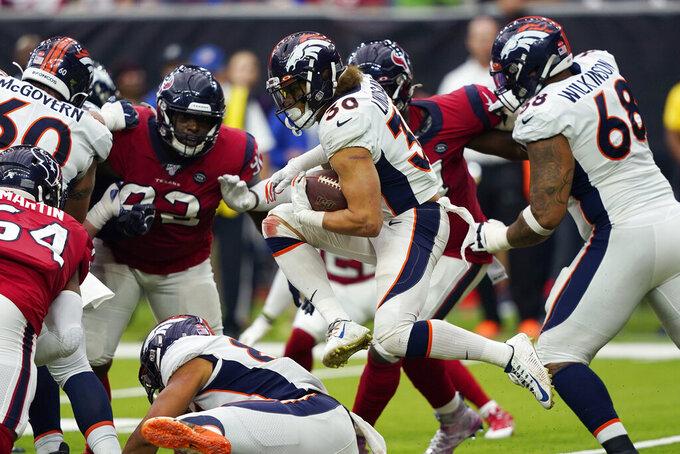 Denver Broncos running back Phillip Lindsay (30) runs against the Houston Texans during the second half of an NFL football game Sunday, Dec. 8, 2019, in Houston. (AP Photo/David J. Phillip)