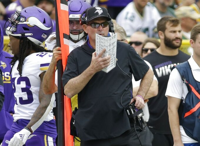 Minnesota Vikings head coach Mike Zimmer calls a play during the first half of an NFL football game against the Green Bay Packers Sunday, Sept. 15, 2019, in Green Bay, Wis. (AP Photo/Mike Roemer)