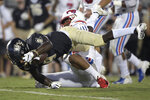 Central Florida running back Adrian Killins Jr. (9) dives over the goal line for a 15-yard rushing touchdown past SMU safety Mikial Onu during the first half of an NCAA college football game Saturday, Oct. 6, 2018, in Orlando, Fla. (AP Photo/Phelan M. Ebenhack)
