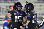TCU quarterback Max Duggan (15) and running back Darwin Barlow (24) celebrate Duggan's touchdown against Louisiana Tech in the first half during an NCAA college football game, Saturday, Dec. 12, 2020. (AP Photo/Richard W. Rodriguez)