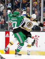 Carolina Hurricanes right wing Andrei Svechnikov (37) and Boston Bruins defenseman Brandon Carlo (25) collide along the boards during the first period of an NHL hockey game, Tuesday, March 5, 2019, in Boston. (AP Photo/Mary Schwalm)
