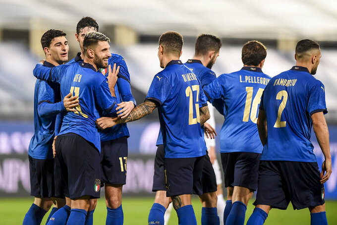 Italy's Vincenzo Grifo, front left, celebrates scoring the third goal of the game during the international friendly soccer match between Italy and Estonia, at the Artemio Franchi Stadium in Florence, Italy, Wednesday, Nov. 11, 2020. (Fabio Ferrari/LaPresse via AP)