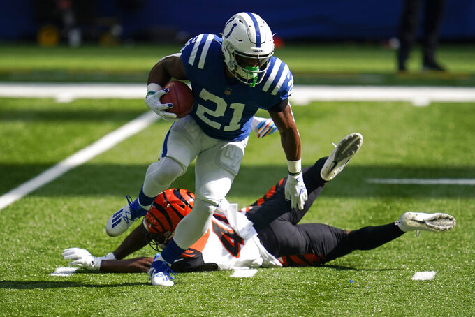Indianapolis Colts' Nyheim Hines (21) runs past Cincinnati Bengals' Brandon Wilson (40) during the first half of an NFL football game, Sunday, Oct. 18, 2020, in Indianapolis. (AP Photo/Michael Conroy)
