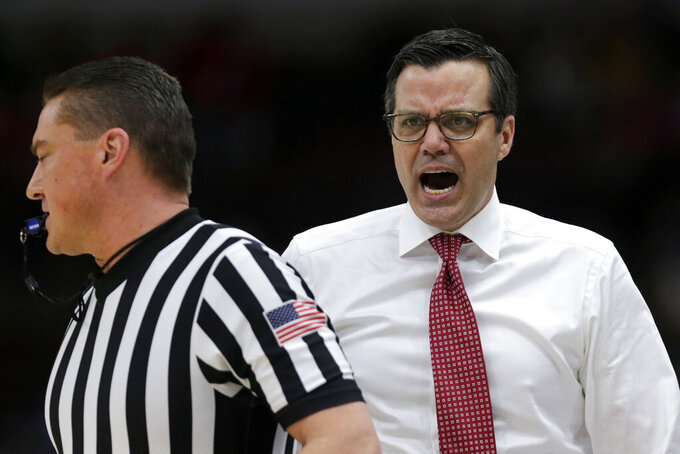 Nebraska head coach Tim Miles argues a call during the first half of an NCAA college basketball game against the Maryland in the second round of the Big Ten Conference tournament, Thursday, March 14, 2019, in Chicago. (AP Photo/Kiichiro Sato)