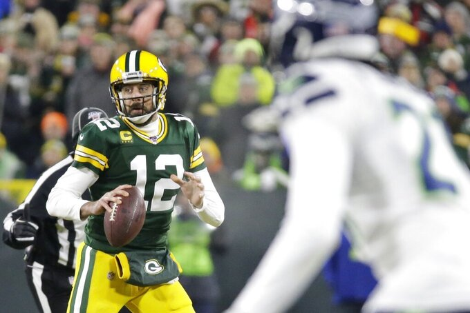Green Bay Packers' Aaron Rodgers drops back during the first half of an NFL divisional playoff football game against the Seattle Seahawks Sunday, Jan. 12, 2020, in Green Bay, Wis. (AP Photo/Mike Roemer)