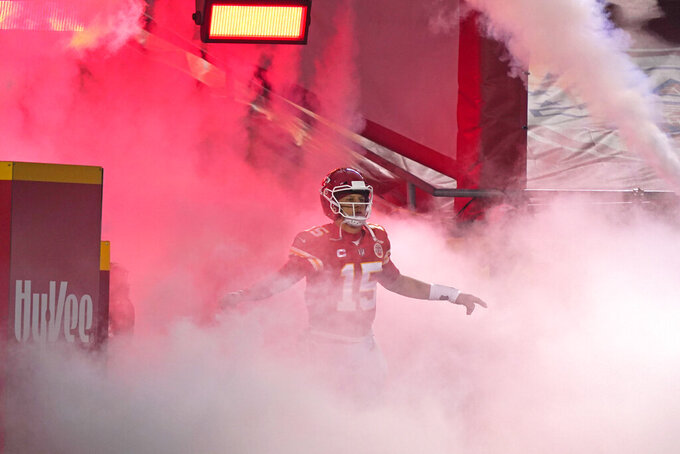 Kansas City Chiefs quarterback Patrick Mahomes runs onto the field before the AFC championship NFL football game against the Buffalo Bills, Sunday, Jan. 24, 2021, in Kansas City, Mo. (AP Photo/Jeff Roberson)