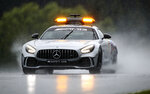 The safety car drives through the rain prior to the qualifying for the Styrian Formula One Grand Prix at the Red Bull Ring racetrack in Spielberg, Austria, Saturday, July 11, 2020. The Styrian F1 Grand Prix will be held on Sunday. (Mark Thompson/Pool via AP)