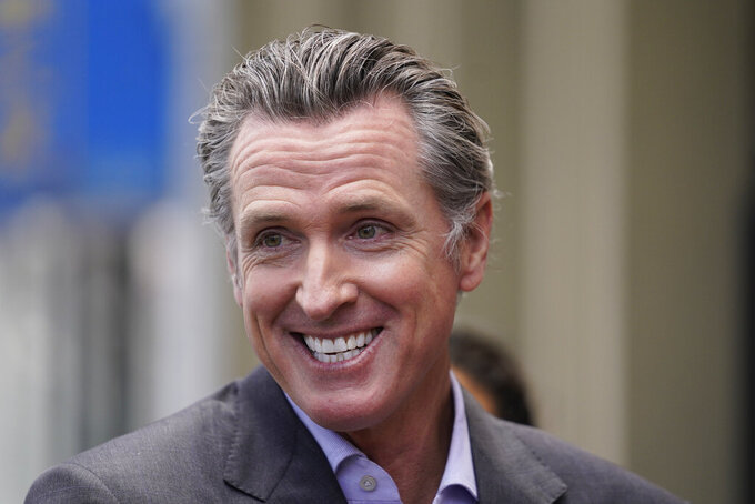 California Gov. Gavin Newsom smiles during a news conference in San Francisco, on Thursday,  June 3, 2021. California Gov. Gavin Newsom has signed an executive order that will lift most of the state's coronavirus rules. The order Newsom signed Friday, June 11, 2021, takes effect on Tuesday. It will end the state's stay-at-home order and its various amendments. (AP Photo/Eric Risberg)