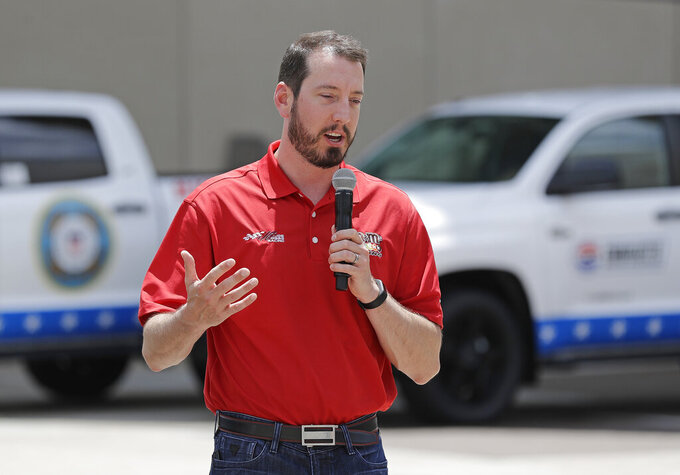 Driver Kyle Busch talks about defending his title in the Coca-Cola 600 NASCAR Cup series auto race during a news conference in Charlotte, N.C., Wednesday, May 8, 2019. (AP Photo/Chuck Burton)