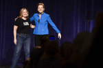 Elizabeth Warren, United States senator from Massachusetts and one of the many Democrats running for president in 2020, enters the stage with San Juan Mayor Carmen Yulin Cruz Soto, moments before the beginning of the