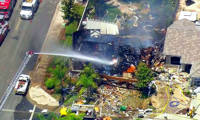 This image from video provided by CBS-LA shows the aftermath of an explosion that destroyed a house Murrieta, Calif., sending up thick flames and closing several streets, Monday, July 15, 2019. One Southern California Gas Company employee was killed. (CBS-LA via AP)