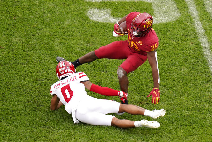 Iowa State running back Breece Hall (28) is tackled by Louisiana-Lafayette safety Kam Pedescleaux (0) during the first half of an NCAA college football game, Saturday, Sept. 12, 2020, in Ames, Iowa. (AP Photo/Charlie Neibergall)
