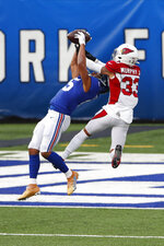 New York Giants' Golden Tate, left, catches a pass in front of Arizona Cardinals' Byron Murphy during the second half of an NFL football game, Sunday, Dec. 13, 2020, in East Rutherford, N.J. (AP Photo/Noah K. Murray)