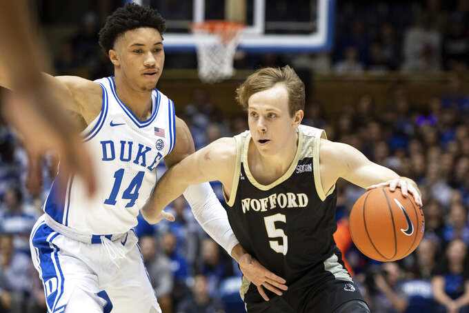 Wofford's Storm Murphy (5) drives against Duke's Jordan Goldwire (14) during the first half of an NCAA college basketball game in Durham, N.C., Thursday, Dec. 19, 2019. (AP Photo/Ben McKeown)