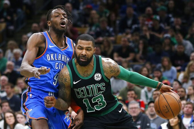 Boston Celtics' Marcus Morris (13) drives past Oklahoma City Thunder's Jerami Grant (9) during the first half of an NBA basketball game in Boston, Sunday, Feb. 3, 2019. (AP Photo/Michael Dwyer)