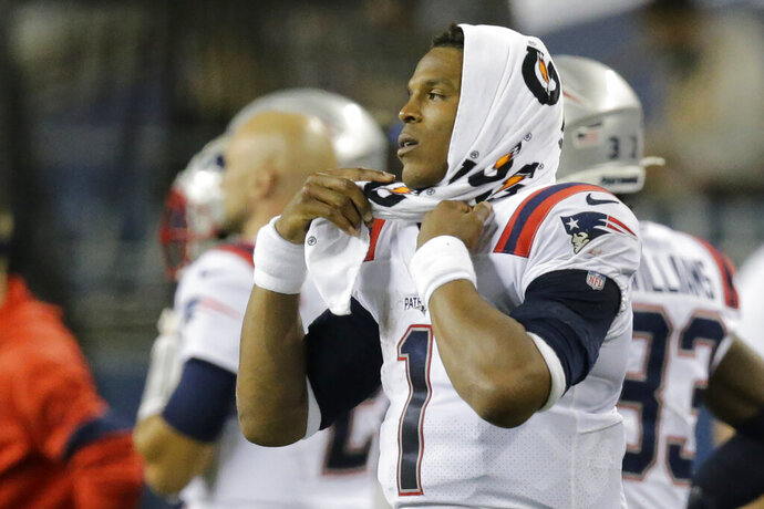 New England Patriots quarterback Cam Newton (1) reacts on the sideline during the fourth quarter of an NFL football game against the Seattle Seahawks, Sunday, Sept. 20, 2020, in Seattle. The Seahawks won 35-30. (AP Photo/John Froschauer)
