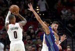 Portland Trail Blazers guard Damian Lillard, left, shoots a basket over Charlotte Hornets guard Jeremy Lamb, center, as center Jusuf Nurkic, right, sets a pick during the first half of an NBA basketball game in Portland, Ore., Friday, Jan. 11, 2019. (AP Photo/Steve Dykes)