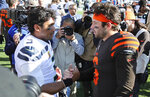 Seattle Seahawks quarterback Russell Wilson (3) and Cleveland Browns quarterback Baker Mayfield (6) talk after an NFL football game, Sunday, Oct. 13, 2019, in Cleveland. (AP Photo/Ron Schwane)