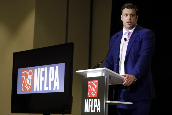Eric Winston, president of the NFL Players Association, speaks at the annual state of the NFLPA press conference, Thursday, Jan. 30, 2020, in Miami Beach, Fla. The San Francisco 49ers will face the Kansas City Chiefs in the NFL Super Bowl 54 football game Sunday. (AP Photo/Chris Carlson)