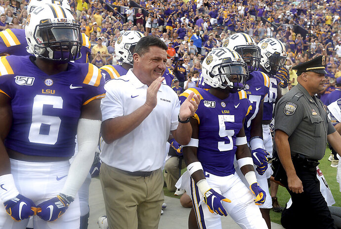 LSU head football coach Ed Orgeron leads his players onto the field before LSU's 65-14 NCAA football game victory over Northwestern State Saturday in Baton Rouge, La., Sept. 14, 2019. (AP Photo/Patrick Dennis)