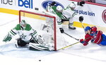 Montreal Canadiens right wing Andrew Shaw (65) tries to score on the wrap-around past Dallas Stars goaltender Kari Lehtonen (32) as he is covered by center Jason Dickinson (16) and defenseman Dan Hamhuis (2) during the second period of an NHL hockey game in Montreal on Tuesday, March 13, 2018. (Paul Chiasson/The Canadian Press via AP)