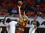 Iowa State guard Lindell Wigginton (5) shoots between Oklahoma State forward Yor Anei (14) and guard Isaac Likekele (13) during the second half of an NCAA college basketball game in Stillwater, Okla., Wednesday, Jan. 2, 2019. (AP Photo/Sue Ogrocki)