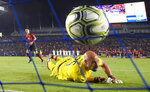 FILE - In this July 25, 2018, file photo, AC Milan goalkeeper Pepe Reina, right, is scored on by Manchester United midfielder Ander Herrera during a penalty shootout in the International Champions Cup tournament soccer match in Carson, Calif. Manchester United won on a 9-8 penalty shootout following a 1-1 tie in regulation. The photo was part of a series of images by photographer Mark J. Terrill which won the Thomas V. diLustro best portfolio award for 2018 given out by the Associated Press Sports Editors during their annual winter meeting in in Lake Buena Vista, Fla. (AP Photo/Mark J. Terrill, File)