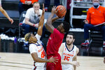 Rutgers guard Montez Mathis (10) shoots over Illinois guard Adam Miller (44) in the first half of an NCAA college basketball game at the Big Ten Conference tournament in Indianapolis, Friday, March 12, 2021. (AP Photo/Michael Conroy)