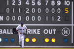 Boston Red Sox left fielder J.D. Martinez heads to the dugout after the top of the 10th inning, in which pitcher Hansel Robles gave up five runs to the Minnesota Twins during a baseball game at Fenway Park, Wednesday, Aug. 25, 2021, in Boston. (AP Photo/Charles Krupa)