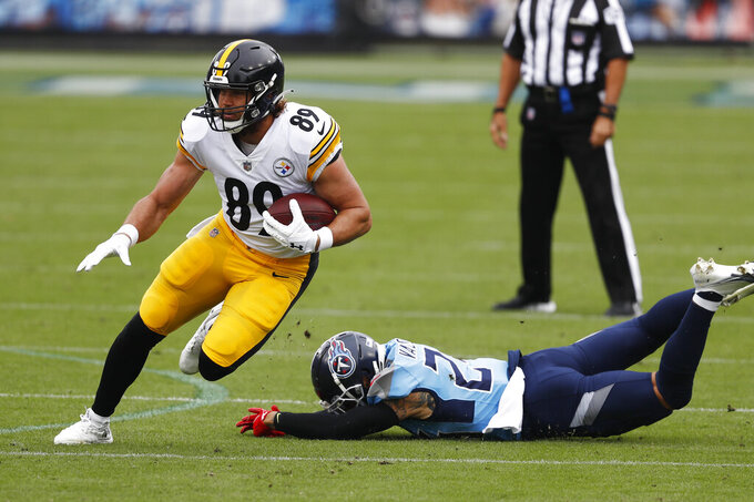 Pittsburgh Steelers tight end Vance McDonald (89) gets past Tennessee Titans strong safety Kenny Vaccaro (24) in the first half of an NFL football game Sunday, Oct. 25, 2020, in Nashville, Tenn. (AP Photo/Wade Payne)