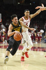 Missouri guard Jordan Geist (15) drives past Arkansas defender Jalen Harris (5) during the second half of an NCAA college basketball game, Wednesday, Jan. 23, 2019, in Fayetteville, Ark. (AP Photo/Michael Woods)