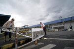 Workers arrange items at the damaged airport as Typhoon Kammuri slammed Legazpi city, Albay province, southeast of Manila, Philippines on Tuesday, Dec. 3, 2019. A powerful typhoon was blowing across the Philippines on Tuesday after slamming ashore overnight in an eastern province, damaging houses and an airport and knocking out power after tens of thousands of people fled to safer ground. (AP Photo)