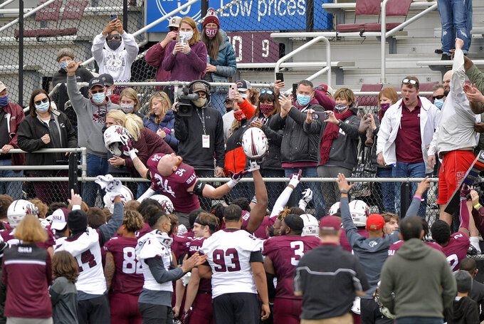 Southern Illinois linebacker Luke Giegling (34) and teammates celebrate in front of fans after a 38-14 win over North Dakota State in an NCAA college football game Saturday, Feb. 29, 2021, in Carbondale, Ill. (Byron Hetzler/The Southern Illinoisan via AP)