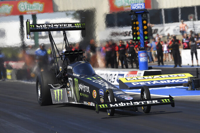 In this photo provided by the NHRA, Brittany Force drives on the way to the No. 1 spot in Top Fuel qualifying at the Menards NHRA Nationals drag races Saturday, Aug. 14, 2021, at Heartland Motorsports Park in Topeka, Kan. (Auto Imagery/NHRA via AP)