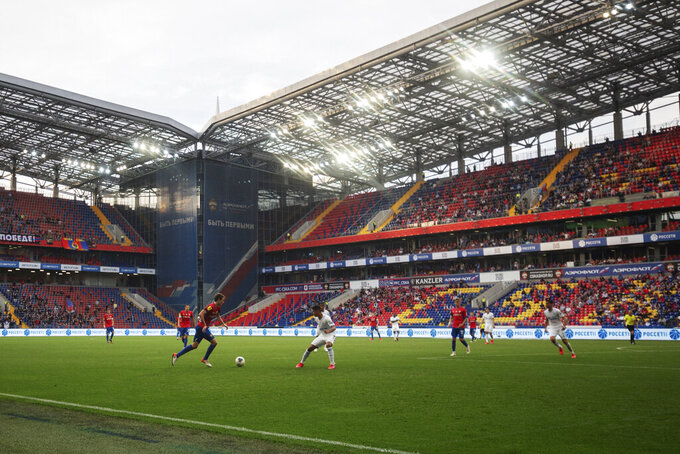 CSKA's Mario Fernandes, center left, controls the ball during the Russia Soccer Premier League soccer match between CSKA Moscow and Zenit St. Petersburg at CSKA Arena in Moscow, Russia, Saturday, June 20, 2020. The match is being played with a minimum spectators to curb the spread of COVID-19.(Denis Tyrin, PFC CSKA Pool photo via AP)