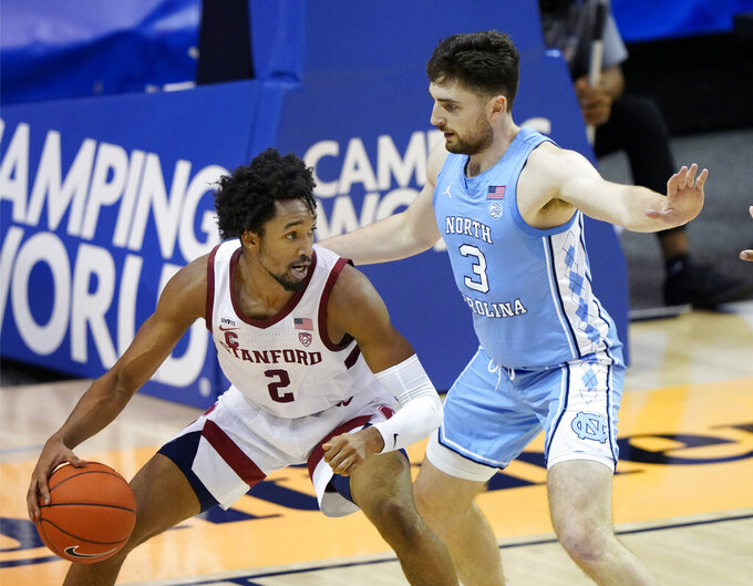 Stanford guard Bryce Wills (2) tries to move the ball around North Carolina guard Andrew Platek (3) during the first half of an NCAA college basketball game in the semifinals of the Maui Invitational, Tuesday, Dec. 1, 2020, in Asheville, N.C. (AP Photo/Kathy Kmonicek)