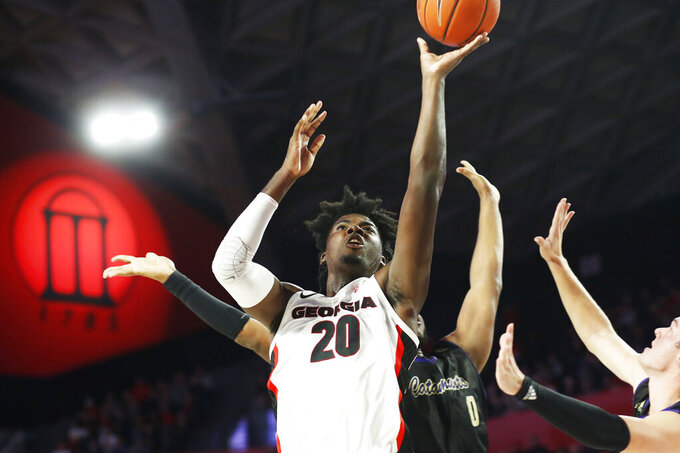 Georgia's Rayshaun Hammonds (20) shoots next to Western Carolina's Carlos Dotson during an NCAA college basketball game Tuesday, Nov. 5, 2019, in Athens, Ga. (Joshua L. Jones/Athens Banner-Herald via AP)