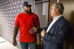 Houston Texans top draft pick Tytus Howard, left, talks to Texans chairman and CEO Cal McNair following an introductory NFL football news conference Friday, April 26, 2019, in Houston. Howard was an offensive lineman for Alabama State. (Brett Coomer/Houston Chronicle via AP)