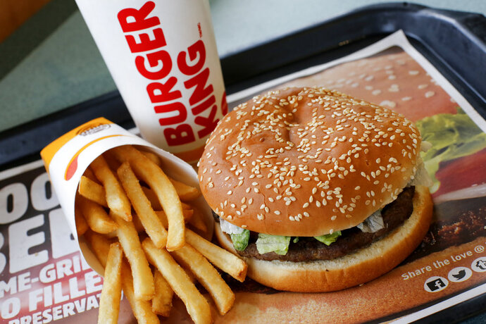 This Feb. 1, 2018, photo shows a Burger King Whopper meal combo at a restaurant in Punxsutawney, Pa. Restaurant Brands International, the parent company of Burger King and Tim Hortons, reports financial results Monday, Feb. 12, 2018. (AP Photo/Gene J. Puskar)
