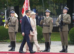 Lithuanian Prime Minister Ingrida Simonyte, centre, being greeted by Poland's Prime Minister Mateusz Morawiecki on a visit for talks that include the region's security in the face of migrant pressure on the two countries' borders with Belarus, in Warsaw, Poland, on Friday, Sept. 17, 2021. (AP Photo/Czarek Sokolowski)