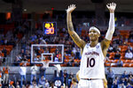 Auburn guard Samir Doughty (10) celebrates the end of a high-scoring first half of an NCAA college basketball game against Colgate, Monday, Nov. 18, 2019, in Auburn, Ala. (AP Photo/Julie Bennett)