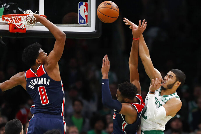 Boston Celtics' Jayson Tatum, right, tries to pass the ball past Washington Wizards' Rui Hachimura (8) and Troy Brown Jr. during the fourth quarter of an NBA basketball game Wednesday, Nov. 13, 2019, in Boston. (AP Photo/Winslow Townson)