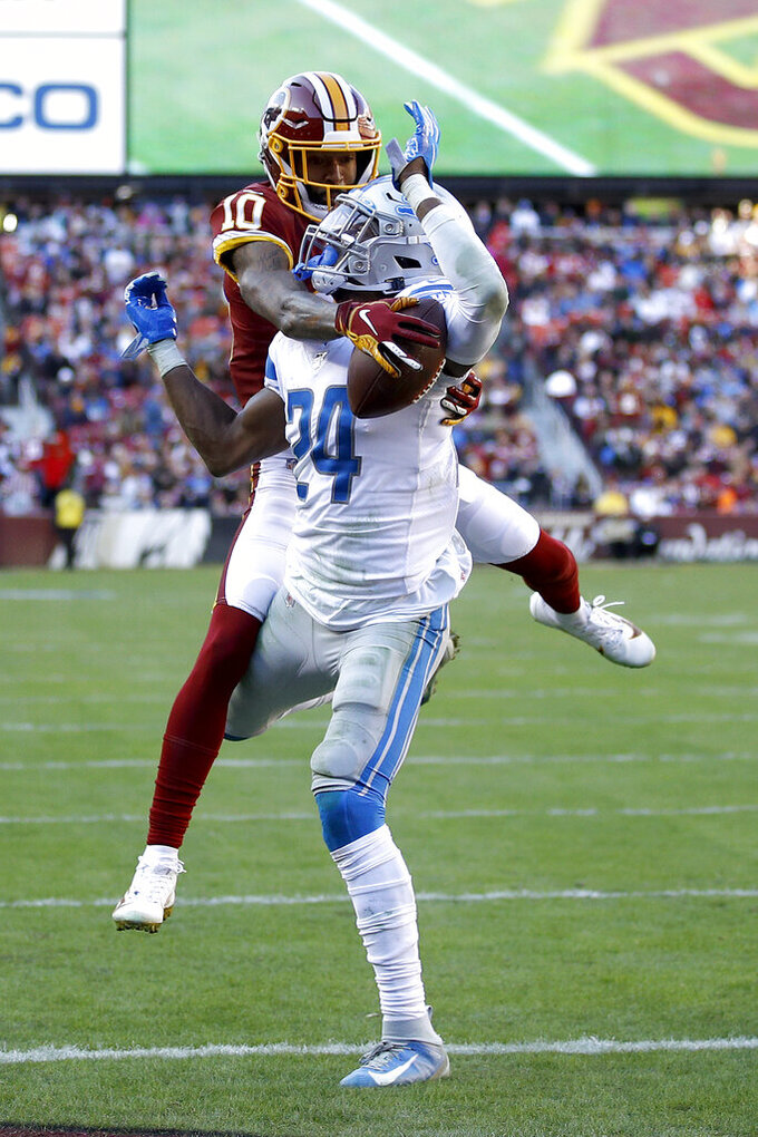 Washington Redskins wide receiver Paul Richardson (10) tries to make a catch as Detroit Lions cornerback Amani Oruwariye (24) defends during the first half of an NFL football game, Sunday, Nov. 24, 2019, in Landover, Md. (AP Photo/Patrick Semansky)