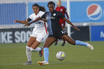 Sky Blue FC foward Ifeoma Onumonu (25) controls the ball as OL Reign midfielder Shirley Cruz, left, defends during the first half of an NWSL Challenge Cup soccer match at Zions Bank Stadium on Tuesday, June 30, 2020, in Herriman, Utah. (AP Photo/Rick Bowmer)