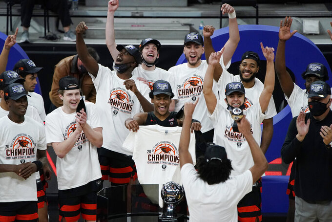 Oregon State players celebrate after defeating Colorado in an NCAA college basketball game in the championship of the Pac-12 men's tournament Saturday, March 13, 2021, in Las Vegas. (AP Photo/John Locher)