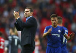 Chelsea's head coach Frank Lampard, left, and Chelsea's Cesar Azpilicueta acknowledge spectators after the English Premier League soccer match between Manchester United and Chelsea at Old Trafford in Manchester, England, Sunday, Aug. 11, 2019. (AP Photo/Dave Thompson)
