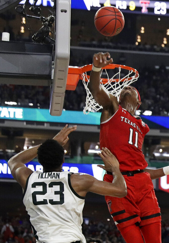 Texas Tech forward Tariq Owens (11) blocks a shot by Michigan State forward Xavier Tillman during the first half in the semifinals of the Final Four NCAA college basketball tournament, Saturday, April 6, 2019, in Minneapolis. (AP Photo/David J. Phillip)