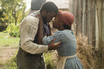 This image released by Focus Features shows Zackary Momoh, left, and Cynthia Erivo as Harriet Tubman in a scene from
