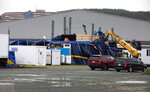 The tent of Iceberg Alley, where concerts had been taking place through the week, suffered major damages after Hurricane Larry crossed over Newfoundland's Avalon Peninsula in the early morning hours, in St. John's, Saturday, Sept. 11, 2021. (Paul Daly/The Canadian Press via AP)