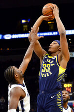 Indiana Pacers center Myles Turner (33) shoots against Memphis Grizzlies forward Solomon Hill, left, in the first half of an NBA basketball game Monday, Dec. 2, 2019, in Memphis, Tenn. (AP Photo/Brandon Dill)